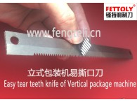 vertical package serrated blade for cutting film